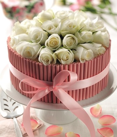 Pink chocolate cigarellos cake
