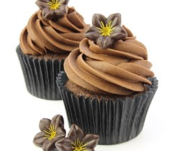 Dark chocolate flower decoration on cupcakes