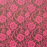 Pink floral swirl chocolate transfer sheets on dark